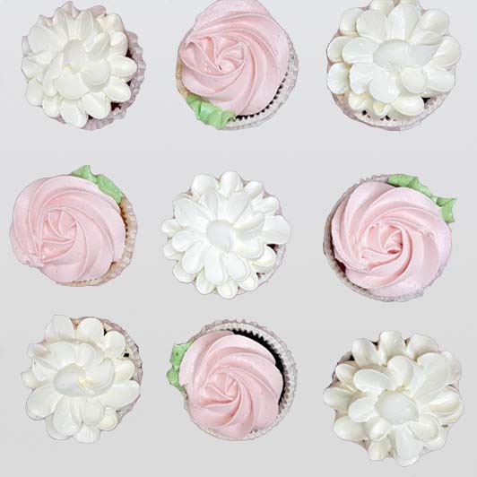white and pink flower cupcakes collection